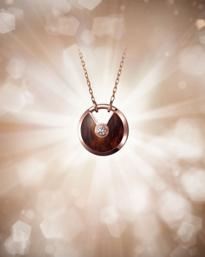 Amulette de Cartier Pendant    Small Model Pink gold, snakewood, a diamond, chain in pink gold