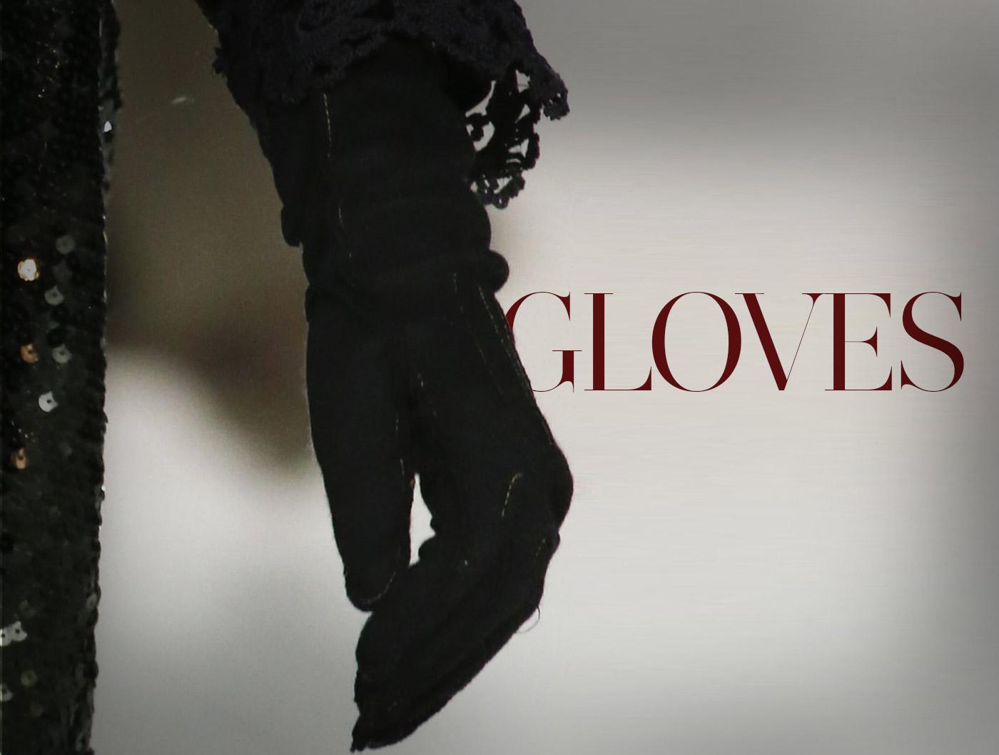 guanti-marc-jacobs-guanti-in-suede-nero-con-cuciture-a-vista-e-impunture-indossati-su-un-abito-arricchito-di-paillettes