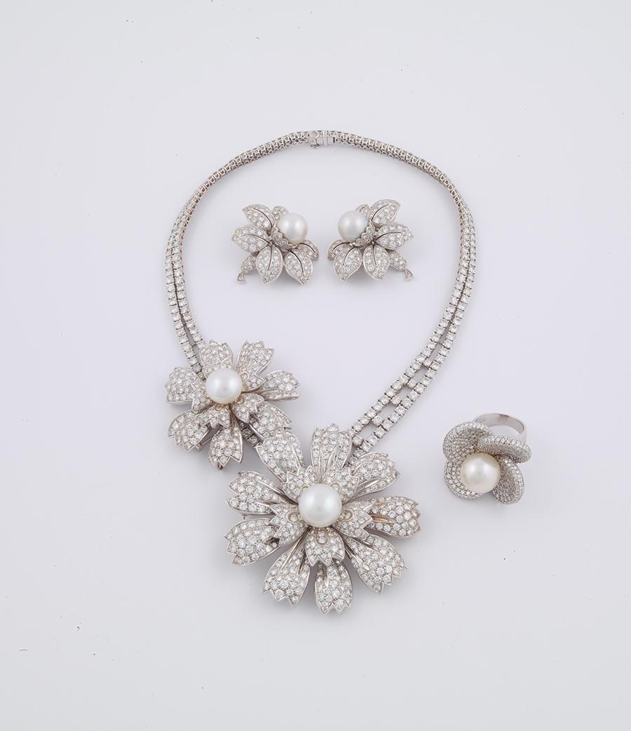 Museo Poldi pezzoli-Pederzani Collana, orecchini anello, inizi anni '80, oro bianco, diamanti, perle. Collezione privata