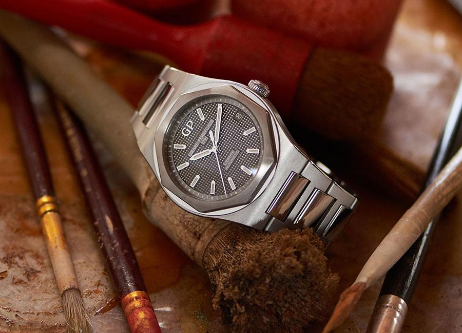 Girard Perregaux-orologio in titanio e oro rosa con maglie alternate lucide e satinate