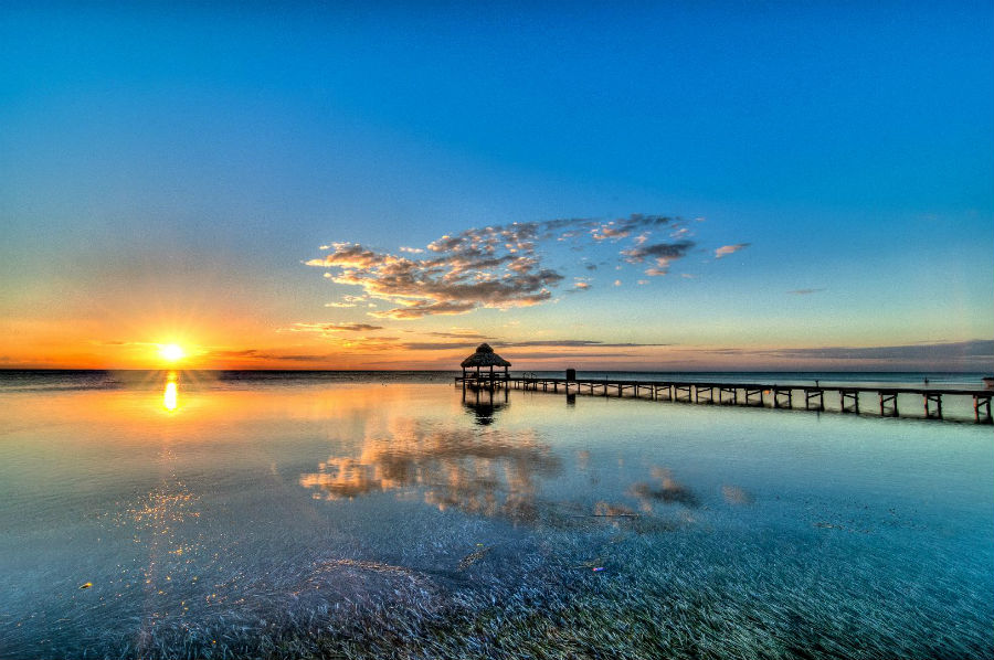 Scorci sul mare del Belize, dove sorgerà l'esclusivo resort Caye Chapel