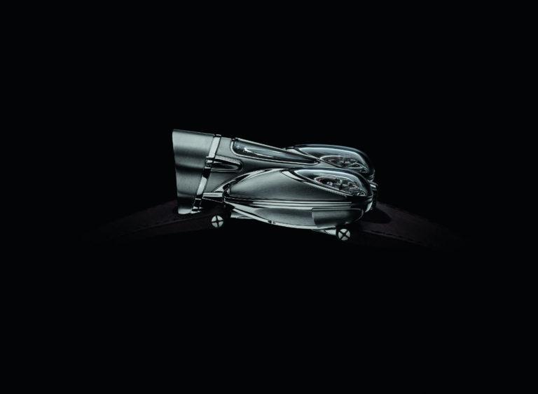 MB&F – Horological Machine N°9 Flow – cassa in titanio grado 5 da 57 x 47 x 23 mm – impermeabile a 3 atmosfere – cinturino in pelle di vitello con chiusura déployante in titanio – movimento meccanico a carica manuale, di manifattura, con doppio bilanciere e differenziale planetario – edizione limitata a 33 esemplari (referenza Road).