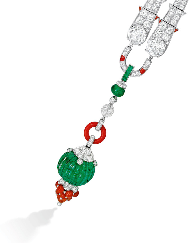 Lot 140 Diamond, Coral, Emerald and Seed Pearl Brooch, Cartier, circa 1925, $250,000-$350,000