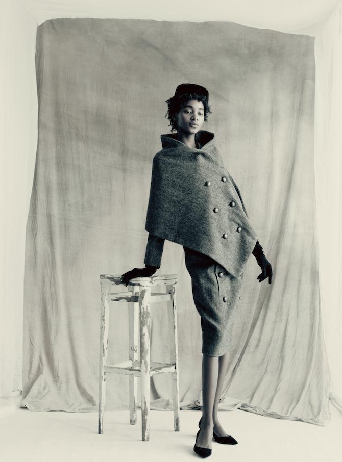 _ VOYAGEUR SUIT _Autumn-Winter 1955 Haute Couture collection Y line by Christian Dior Model: TamiWilliamsStylist: Grace CoddingtonMakeupartist: Lauren Parsons Hairstylist: Julien d'Ys COPYRIGHT: Paolo Roversi