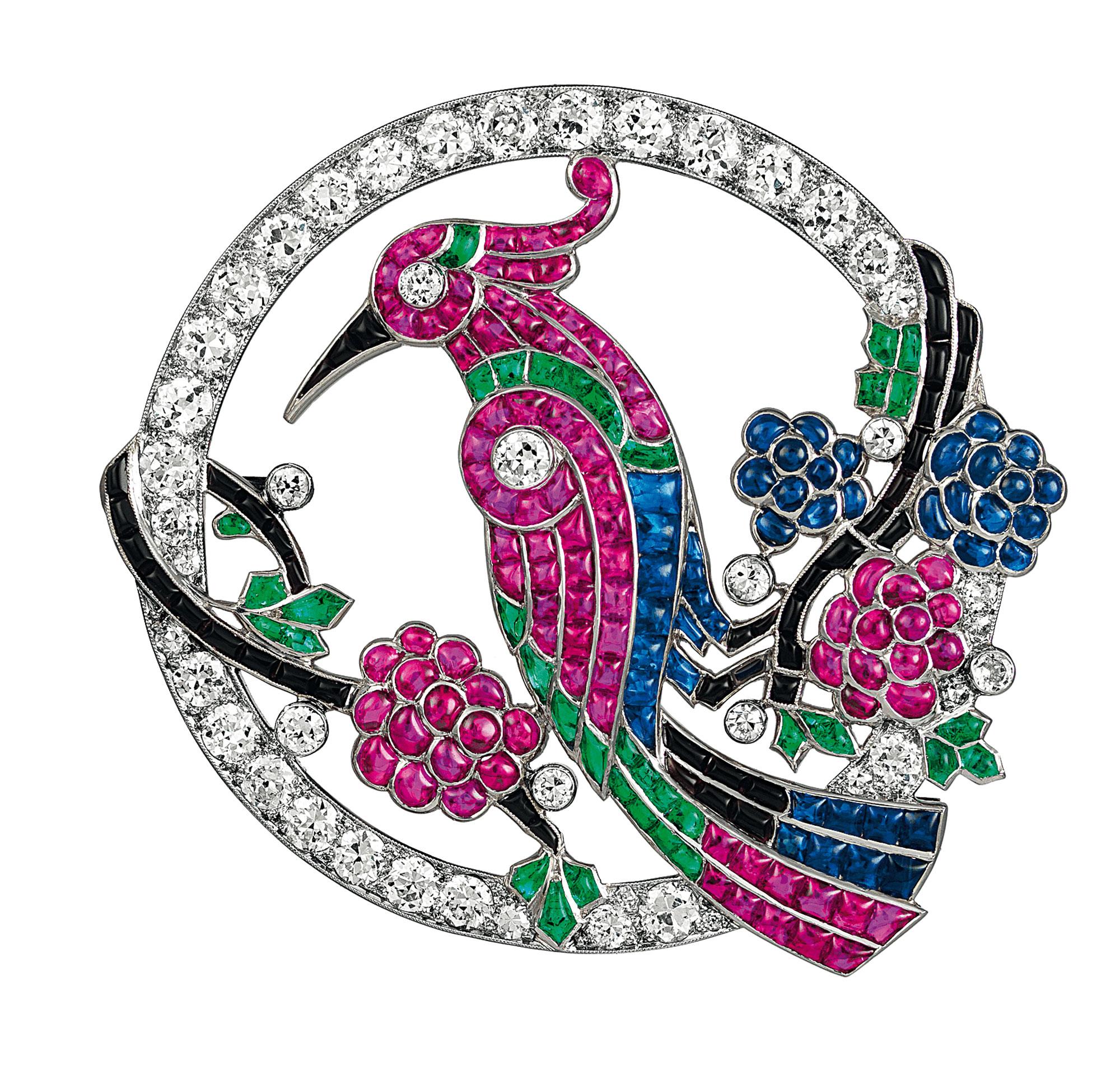 Bird brooch, 1924, Platinum, emeralds, sapphires, rubies, onyx, diamonds Van Cleef & Arpels Collection – Photo Credit: Van Cleef & Arpels